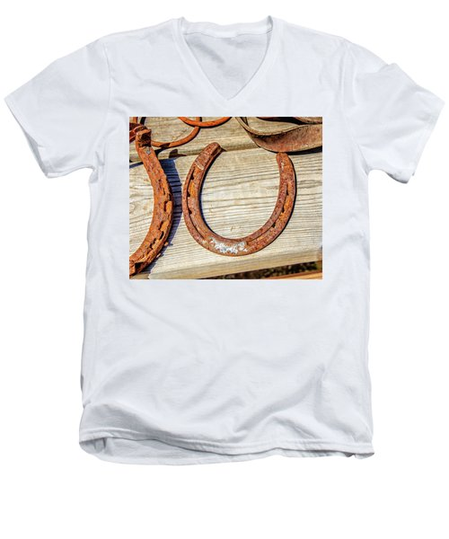 Men's V-Neck T-Shirt featuring the photograph Rusty Horseshoes Found By Curators Of The Ghost Town Of St. Elmo by Peter Ciro