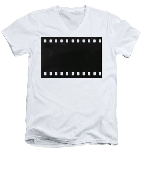 Men's V-Neck T-Shirt featuring the photograph Strip Of Old Celluloid Film With Dust And Scratches by Michal Boubin