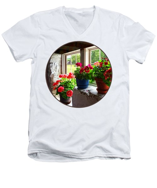 Three Pots Of Geraniums On Windowsill Men's V-Neck T-Shirt by Susan Savad
