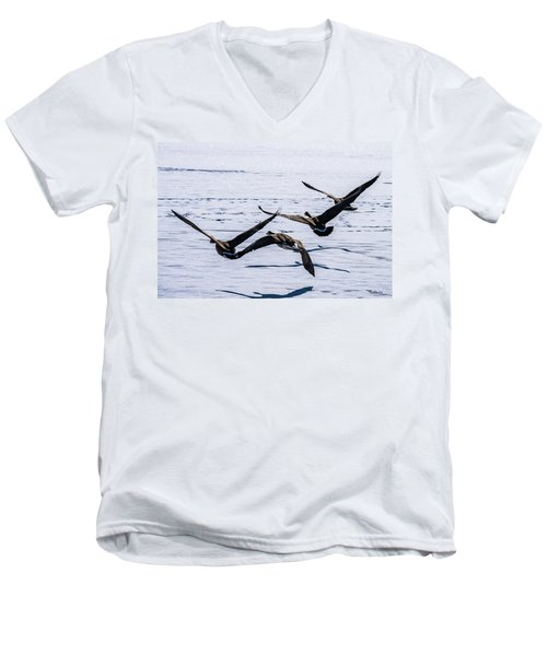 Men's V-Neck T-Shirt featuring the photograph Geese Over Frozen Kitring Pond by Tim Kathka