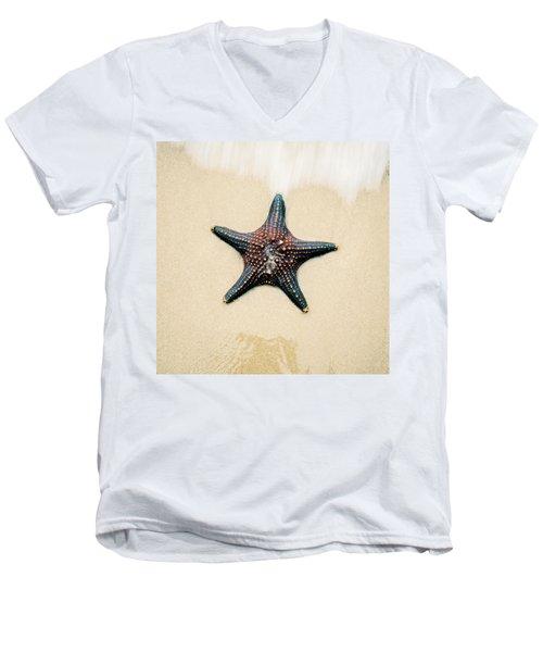 Starfish On The Beach Sand. Close Up. Men's V-Neck T-Shirt