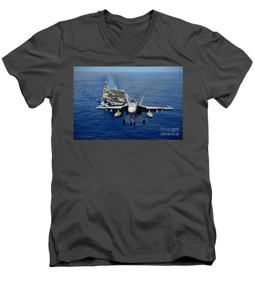 Men's V-Neck T-Shirt featuring the photograph An Fa-18 Hornet Demonstrates Air Power. by Paul Fearn