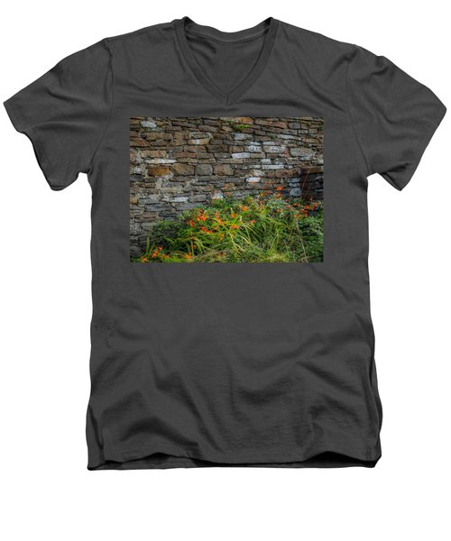 Orange Wildflowers Against Stone Wall Men's V-Neck T-Shirt