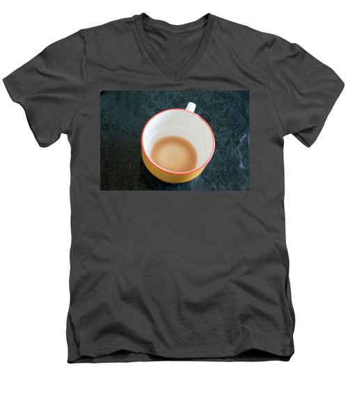A Cup With The Remains Of Tea On A Green Table Men's V-Neck T-Shirt by Ashish Agarwal