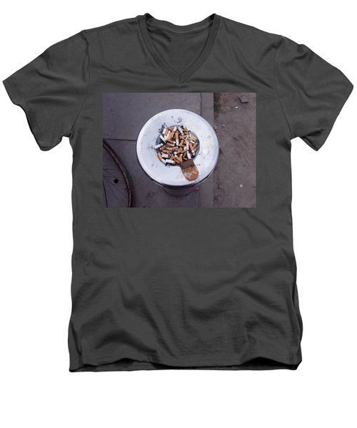 A Lot Of Cigarettes Stubbed Out At A Garbage Bin Men's V-Neck T-Shirt by Ashish Agarwal