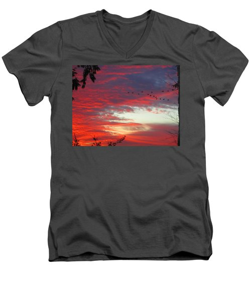 Men's V-Neck T-Shirt featuring the photograph Papaya Colored Sunset With Geese by Kym Backland