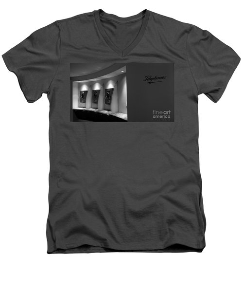 Men's V-Neck T-Shirt featuring the photograph Telephones On Wall by Nina Prommer