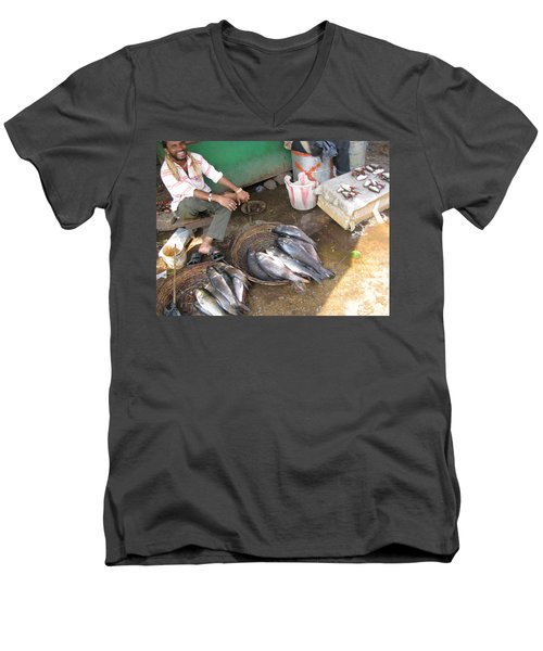 Men's V-Neck T-Shirt featuring the photograph The Fish Seller by David Pantuso