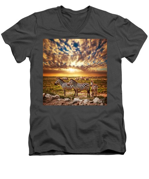 Zebras Herd On African Savanna At Sunset. Men's V-Neck T-Shirt by Michal Bednarek