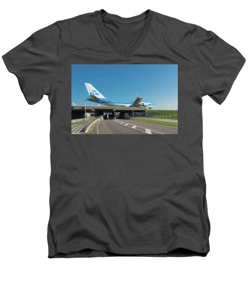 Airplane Over Highway Men's V-Neck T-Shirt by Hans Engbers