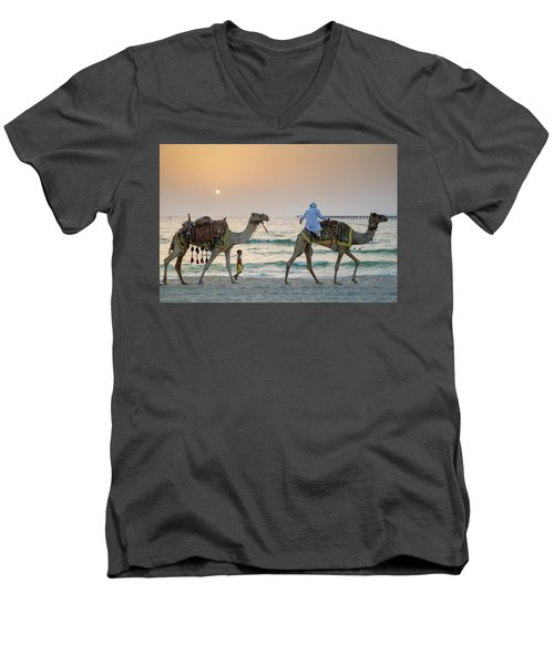 A Little Boy Stares In Amazement At A Camel Riding On Marina Beach In Dubai, United Arab Emirates Men's V-Neck T-Shirt