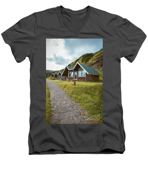 Men's V-Neck T-Shirt featuring the photograph A Row Of Cabins In Iceland by Edward Fielding