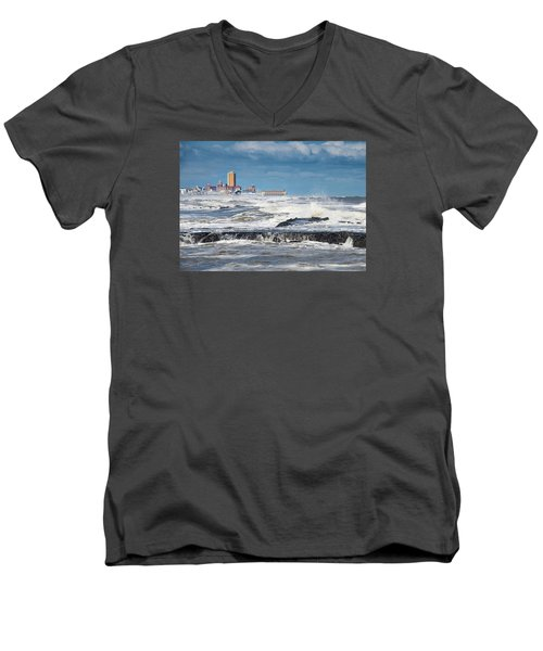 Men's V-Neck T-Shirt featuring the photograph Battering The Seawall At Shark River Inlet by Gary Slawsky