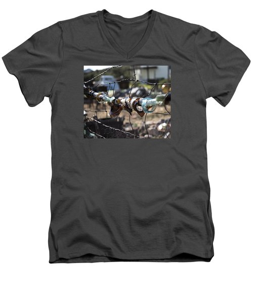 Men's V-Neck T-Shirt featuring the photograph Bottle Fence by Annette Berglund