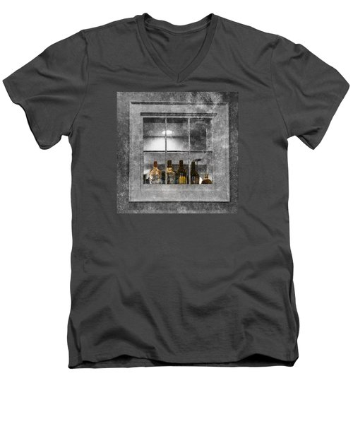 Men's V-Neck T-Shirt featuring the photograph Colored Bottles In Window by Tom Singleton