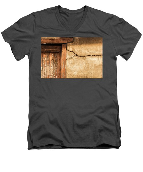 Men's V-Neck T-Shirt featuring the photograph Cracked Lime Stone Wall And Detail Of An Old Wooden Door by Semmick Photo