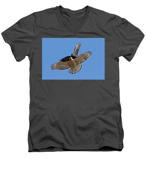 Men's V-Neck T-Shirt featuring the photograph Crow Vs Hawk by Mircea Costina Photography