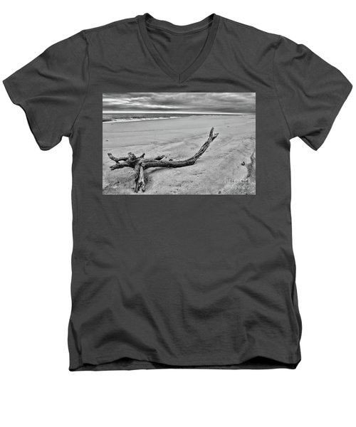 Men's V-Neck T-Shirt featuring the photograph Driftwood On The Beach In Black And White by Paul Ward
