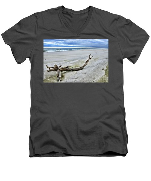 Men's V-Neck T-Shirt featuring the photograph Driftwood On The Beach by Paul Ward