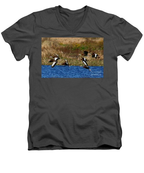 Men's V-Neck T-Shirt featuring the photograph Flight Of The Whistlers by Myrna Bradshaw