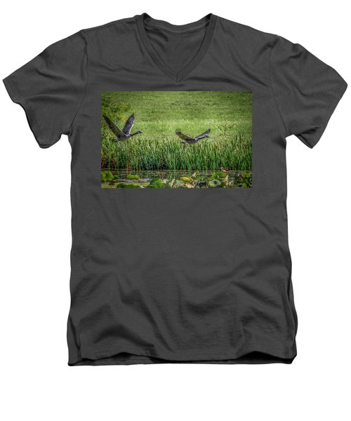Geese In Flight Men's V-Neck T-Shirt by Ray Congrove