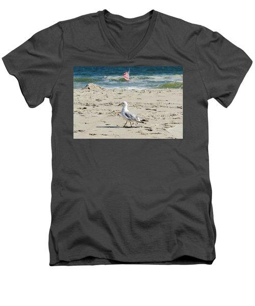 Men's V-Neck T-Shirt featuring the photograph Gull And Flag Rockaway Beach by Maureen E Ritter