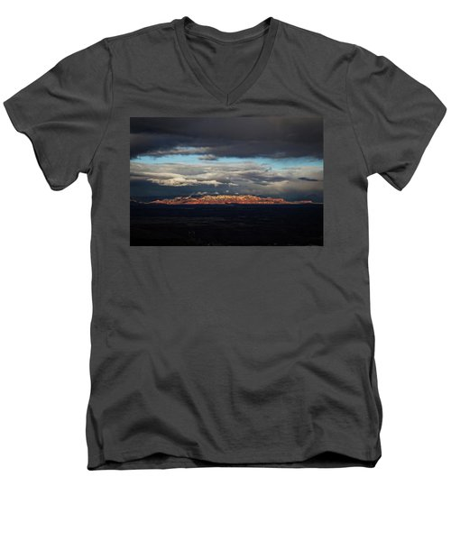 Men's V-Neck T-Shirt featuring the photograph Late Light On Red Rocks With Storm Clouds by Ron Chilston