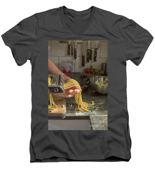 Men's V-Neck T-Shirt featuring the photograph Making Pasta by Patricia Hofmeester