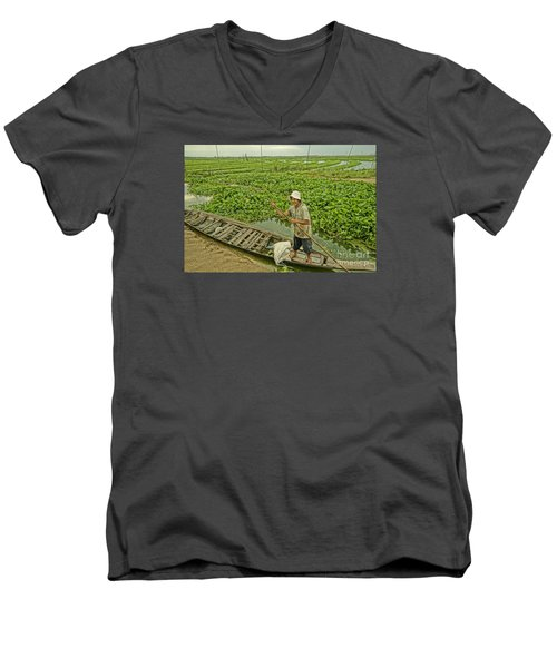 Men's V-Neck T-Shirt featuring the photograph Man Of Daily Life by Arik S Mintorogo