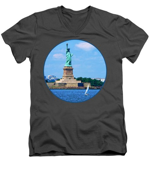 Manhattan - Sailboat By Statue Of Liberty Men's V-Neck T-Shirt by Susan Savad
