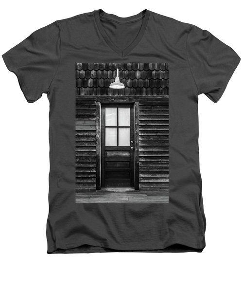 Men's V-Neck T-Shirt featuring the photograph Old Wood Door And Light Black And White by Terry DeLuco