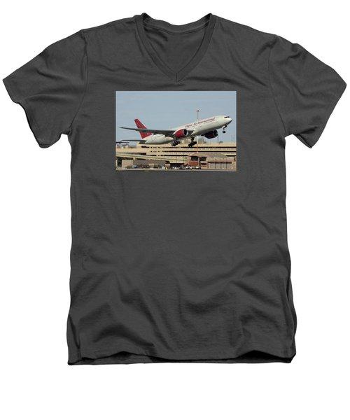 Omni Air International Boeing 777-222 N927ax Phoenix Sky Harbor January 3 2015 Men's V-Neck T-Shirt by Brian Lockett