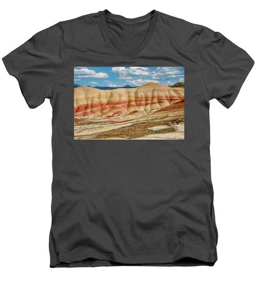 Painted Hills And Afternoon Sky Men's V-Neck T-Shirt by Greg Nyquist