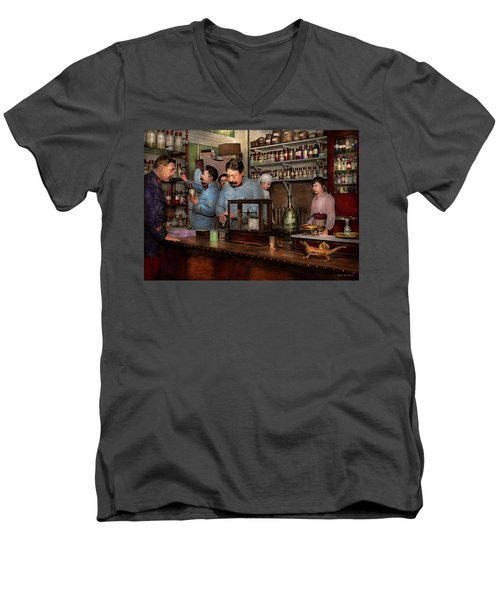 Men's V-Neck T-Shirt featuring the photograph Pharmacy - The Dispensing Chemist 1918 by Mike Savad