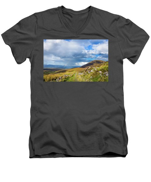 Men's V-Neck T-Shirt featuring the photograph Raining Down And Sunshine With Rainbow On The Countryside In Ire by Semmick Photo