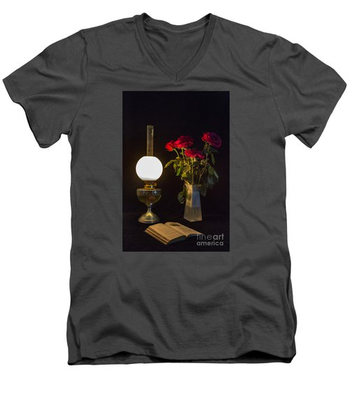 Men's V-Neck T-Shirt featuring the photograph Reading By Oil Lamp by Brian Roscorla