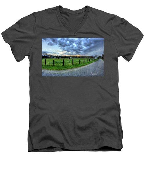 Storm Clouds Over Main Street Men's V-Neck T-Shirt by John Loreaux