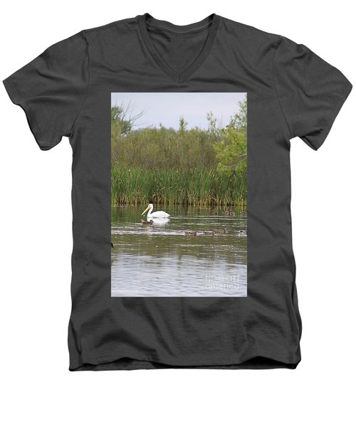 Men's V-Neck T-Shirt featuring the photograph The Pelican And The Ducklings by Alyce Taylor