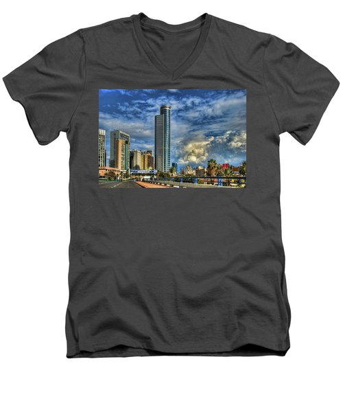 Men's V-Neck T-Shirt featuring the photograph The Skyscraper And Low Clouds Dance by Ron Shoshani