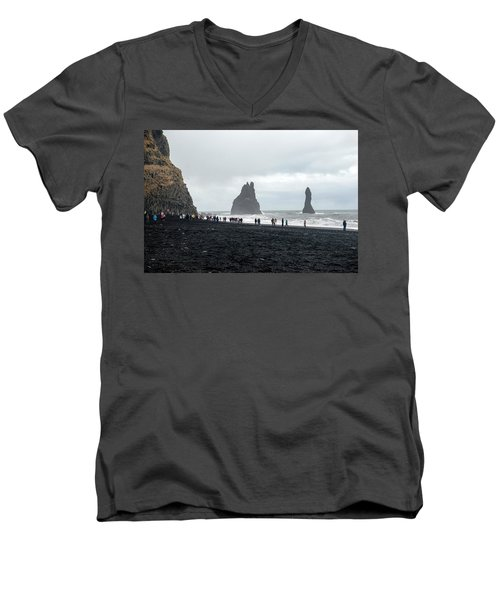 Men's V-Neck T-Shirt featuring the photograph Visitors In Reynisfjara Black Sand Beach, Iceland by Dubi Roman