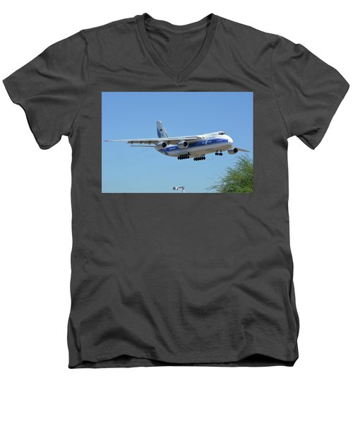 Men's V-Neck T-Shirt featuring the photograph Volga-dnepr An-124 Ra-82068 Landing Phoenix Sky Harbor June 15 2016 by Brian Lockett
