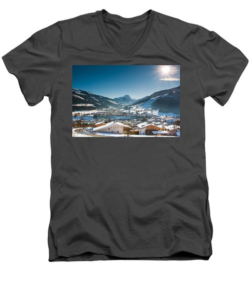 Men's V-Neck T-Shirt featuring the photograph Warm Winter Day In Kirchberg Town Of Austria by John Wadleigh