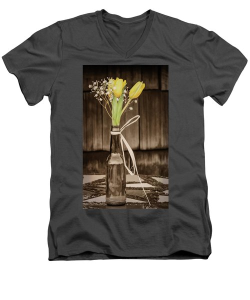 Men's V-Neck T-Shirt featuring the photograph Yellow Tulips In Glass Bottle Sepia by Terry DeLuco