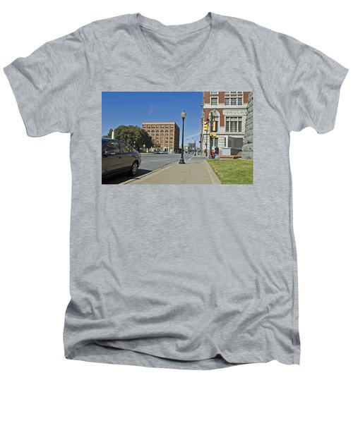 Men's V-Neck T-Shirt featuring the photograph Texas School Book Depository by Charles Beeler