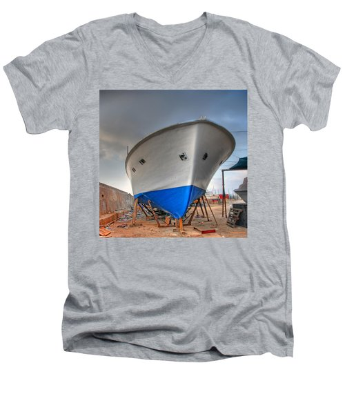 Men's V-Neck T-Shirt featuring the photograph a resting boat in Jaffa port by Ron Shoshani