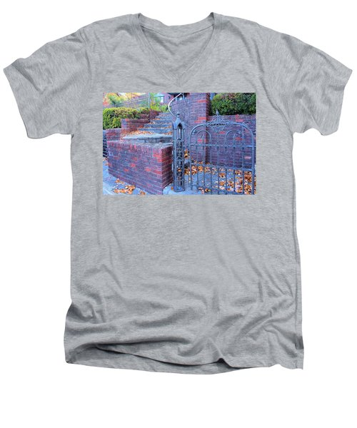 Men's V-Neck T-Shirt featuring the photograph Brick Wall With Wrought Iron Gate by Janette Boyd