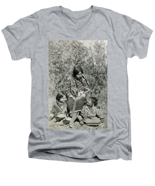 Men's V-Neck T-Shirt featuring the photograph Indian Mother With Daughters by Charles Beeler