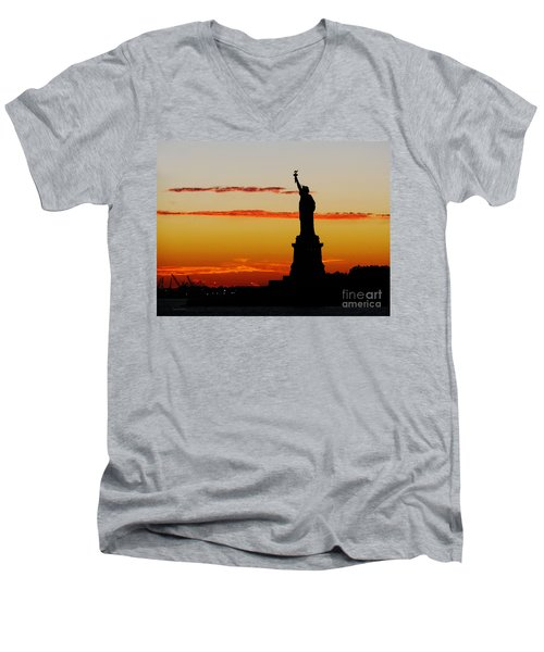 Men's V-Neck T-Shirt featuring the photograph Lady Liberty At Sunset by Susan Wiedmann