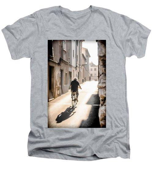 Man Riding Bicycle In Street In Puerto Pollenca Men's V-Neck T-Shirt