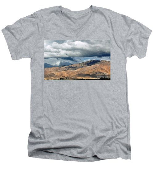 Storm Clouds Floating Above Mountains Men's V-Neck T-Shirt by Susan Wiedmann
